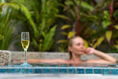 Champagne near swimming pool Royalty Free Stock Photo