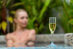 Champagne near swimming pool Stock Images