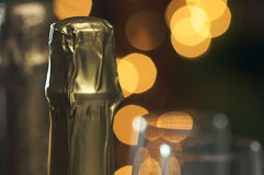 Champagne Neck with Blurry Lights Stock Photo