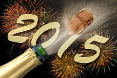 Champagne at new year 2015. Popping Champagne and firework for new year 2015 Stock Photography