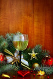 Champagne at New Year's entourage. Christmas garland and a bottle of champagne in the snow before Christmas, or New Year Royalty Free Stock Images