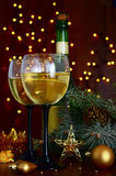 Champagne at New Year's entourage. Christmas garland and a bottle of champagne in the snow before Christmas, or New Year Stock Image