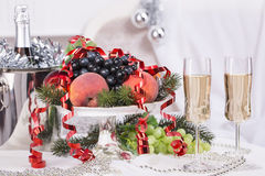 Champagne.New Year's Eve.Celebration. Glasses of champagne, a fruit bowl, a bucket of champagne on New Year's table Stock Photo