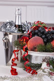 Champagne.New Year's Eve.Celebration. Glasses of champagne, a fruit bowl, a bucket of champagne on New Year's table Stock Photos