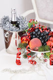 Champagne.New Year's Eve.Celebration. Glasses of champagne, a fruit bowl, a bucket of champagne on New Year's table Stock Photography