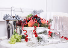 Champagne.New Year's Eve.Celebration. Glasses of champagne, a fruit bowl, a bucket of champagne on New Year's table Stock Images