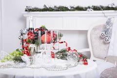 Champagne.New Year's Eve.Celebration. Glasses of champagne, a fruit bowl, a bucket of champagne on New Year's table Royalty Free Stock Photography
