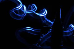 Champagne on New Year's Eve. Flares. New Year's greetings. Happiness and fun Stock Images
