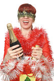 Champagne. A New Year's holiday. The girl with the fastened eyes chooses a champagne Stock Photo