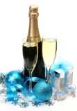 Champagne and New Year's ornaments Royalty Free Stock Photos