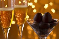 Champagne och choklad Arkivbild