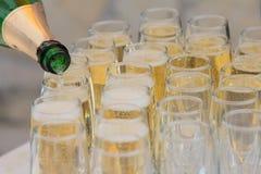 Champagne och exponeringsglas royaltyfri foto