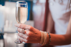 Champagne. One hand clinking a glass of champagne with another Royalty Free Stock Photo