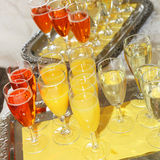 Champagne and orange juice Stock Images