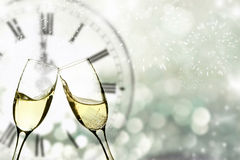 Champagne over fireworks and clock close to midnight Royalty Free Stock Photos