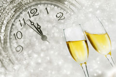 Champagne over fireworks and clock close to midnight Stock Images