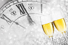 Champagne over fireworks and clock close to midnight Royalty Free Stock Images