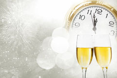 Champagne over fireworks and clock close to midnight Stock Image