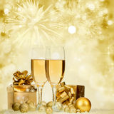 Champagne over fireworks and sparkling holiday lights Stock Photos