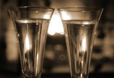 Champagne par l'incendie Images stock