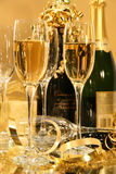 Champagne Party. Champagnes glasses with bottles ready for festivities royalty free stock photography