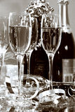 Champagne Party. Champagnes glasses with bottles ready for festivities royalty free stock photos