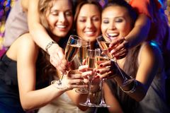 Champagne party. Cheerful girls clinking glasses of champagne at the party stock photo