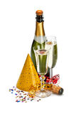 Champagne and party caps Royalty Free Stock Image