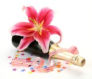 Champagne and pink lily Royalty Free Stock Images