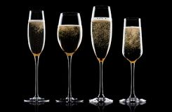 Champagne rose glasses with bubbles on black Stock Image