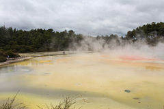 Champagne Pool. At Wai-O-Tapu geothermal wonderland New Zealand, with a walkway across the middle Royalty Free Stock Photography