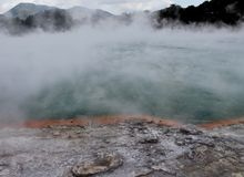 THE CHAMPAGNE POOL, A BUBBLING STEAMING HOT SPRING, GEOTHERMAL WONDERLAND, NEW ZEALAND. The Champagne Pool is one of the signature attractions occurring in Wai-O royalty free stock photo