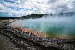 Champagne pool in Rotorua, New Zealand at Sunrise. Sunrise at Champagne Pool in Wai-O-Tapu thermal wonderland in Rotorua, New Zealand. Rotorua is known for Stock Image