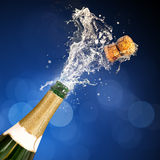 Champagne Popping Bottle. A champagne bottle popping open. Celebrations Stock Image