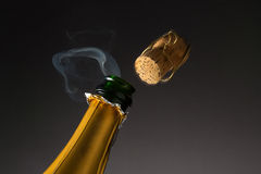 Champagne popping with steam Stock Images