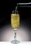Champagne Pour. Bubbly Champagne Pouring Into a Crystal Flute Royalty Free Stock Photos