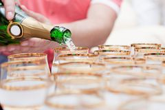 Champagne pour into glasses. Champagne is poured into glasses at the wedding Stock Photography