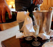 Champagne pour. Man pouring a glass of champagne Royalty Free Stock Image
