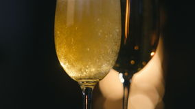 Champagne is poured into a glass. Christmas fireplace stock video