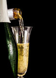 Champagne is poured into glass Stock Photo