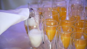 Champagne is poured into a glass, slow motion stock footage