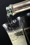 Champagne poured in to the glass Stock Images