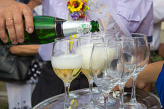 Champagne is poured Royalty Free Stock Photography