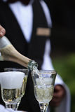 Champagne pouring Stock Image