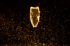 Champagne pouring. In glass on a black background Stock Image
