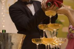 Champagne pouring Stock Photos