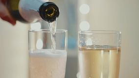 Champagne pouring from the bottle. Slow motion video