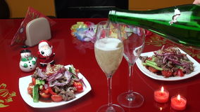 Champagne pouring from bottle. Two candles. Happy. We pour champagne into glasses. burning candles. Thai salad two servings stock video footage