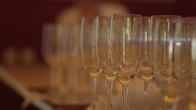 Champagne Pouring from the bottle. Two Flutes with Sparkling Wine over Holiday Bokeh Blinking Background. Couple of champagne Glasses closeup. Success stock video
