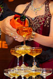 Champagne pouring ceremony at wedding dinner Royalty Free Stock Photos